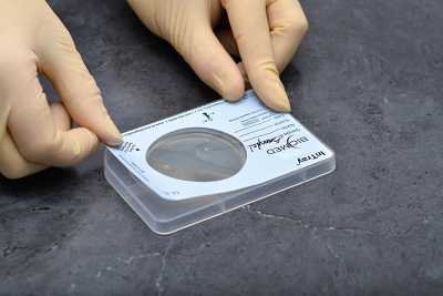 Ensure tension across the label and reattach it to the device